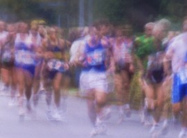 Marathon runners on road (blurred motion)