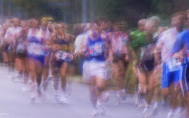 Marathon runners on road (blurred motion)